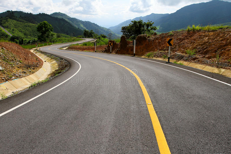 Asphalt roadway. With yellow line royalty free stock photo
