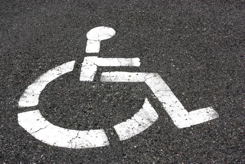 Asphalt-Rollstuhl lizenzfreies stockbild