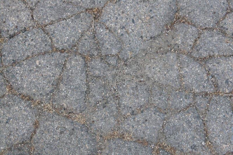 Asphalt With Sand et saleté criqués photos libres de droits