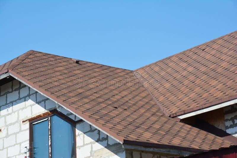 Asphalt shingles house attic problem area waterproofing details. Problem Areas for House asphalt shingles corner Roofing stock photography