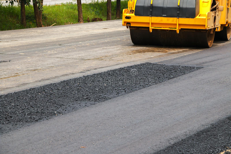 Asphalt spreader. In work on site stock images