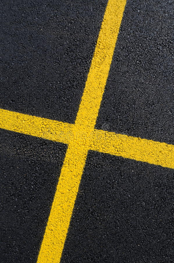 Asphalt surface with yellow line stock photos
