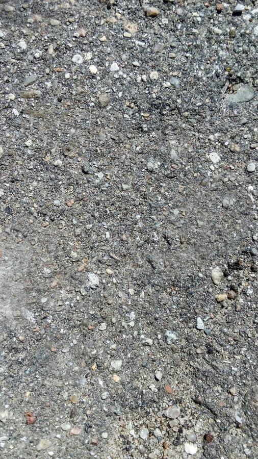 Asphalt texture, abstract gray background closeup shot, vertical.  royalty free stock images