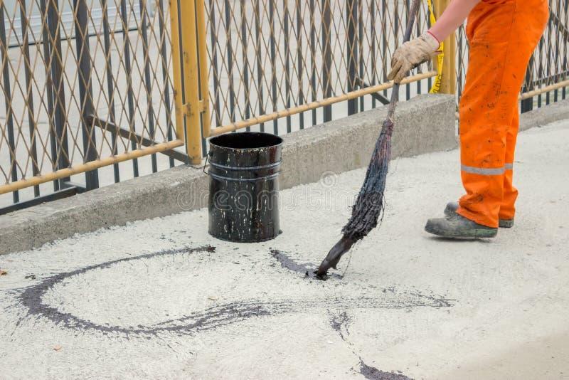 Download Asphalt Worker Apply Tack Coat (Bitumen Emulsion) With A Broom. Stock Image - Image of green, ground: 33531975