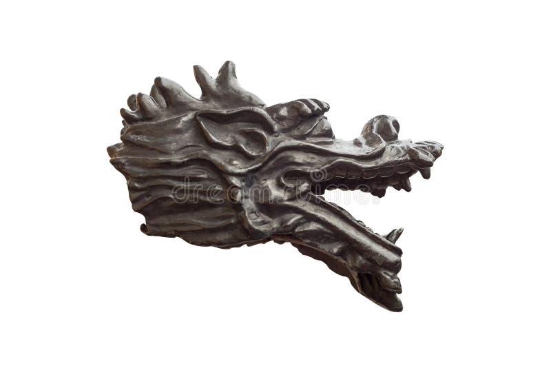 Asphaltieren Sie Skulptur des Drachekopfeinhorns auf weißem Hintergrund stockbild