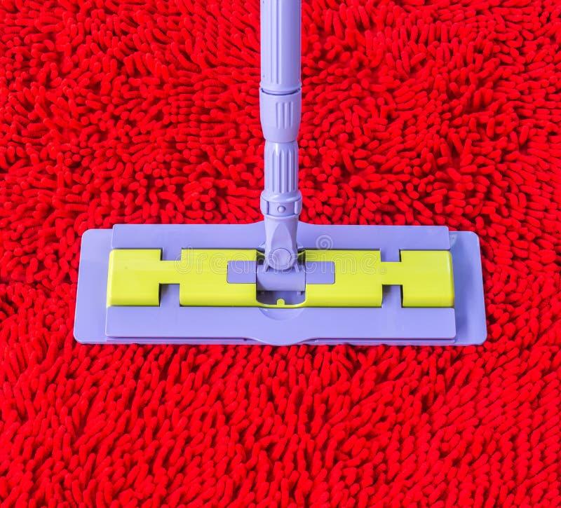 Aspirador en la alfombra roja fotografía de archivo libre de regalías