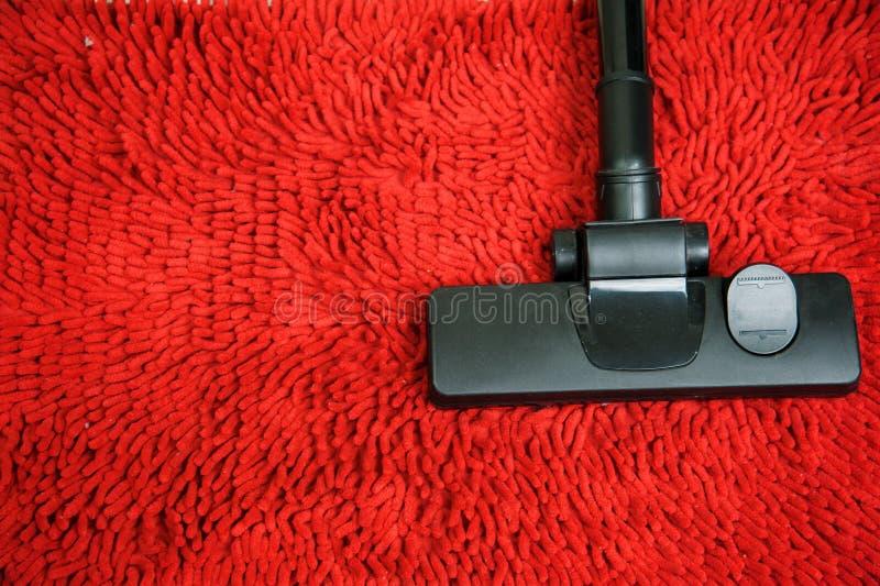 Aspirador en la alfombra roja foto de archivo libre de regalías