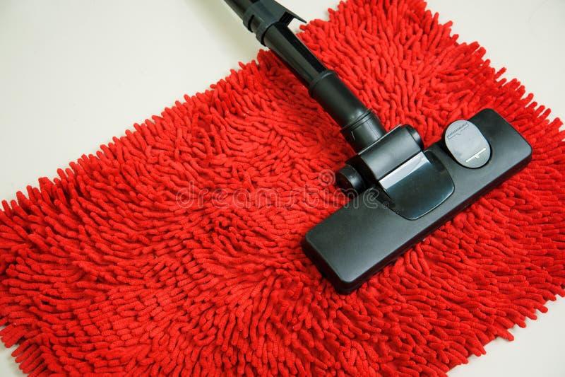 Aspirador en la alfombra roja fotos de archivo libres de regalías