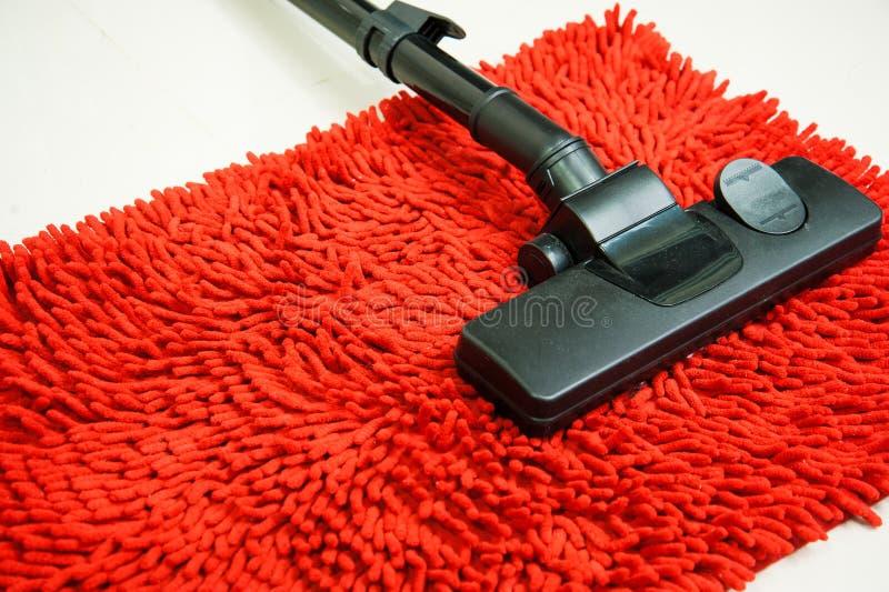 Aspirador en la alfombra roja imagen de archivo libre de regalías