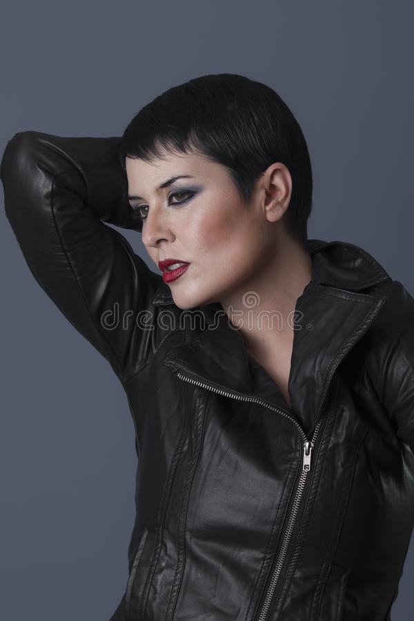 Aspirations, brunette biker with black leather jacket stock photography