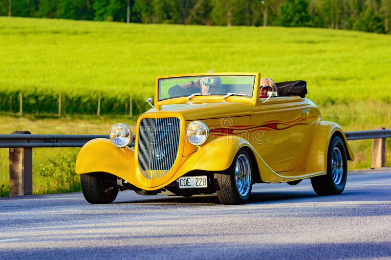 ASPT 1993. Ronneby, Sweden - June 26, 2015: Veteran car street cruise on public roads. Yellow ASPT 1993 with flames stock image