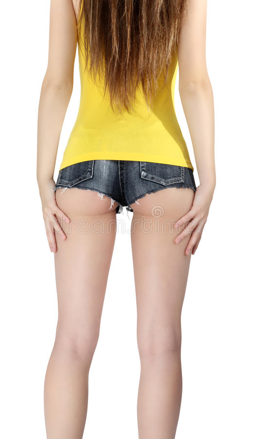 woman wearing a short jeans shorts with yellow tank top stock image