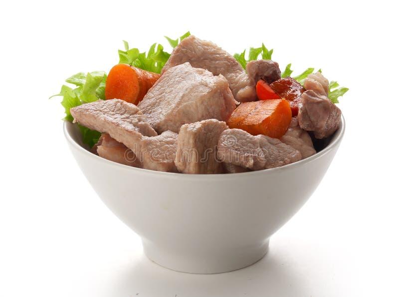 Assado de carne de porco na bacia fotografia de stock