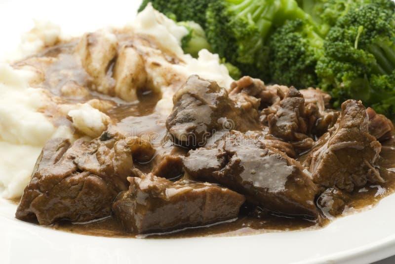Assado de potenciômetro da carne com vegetais imagem de stock royalty free