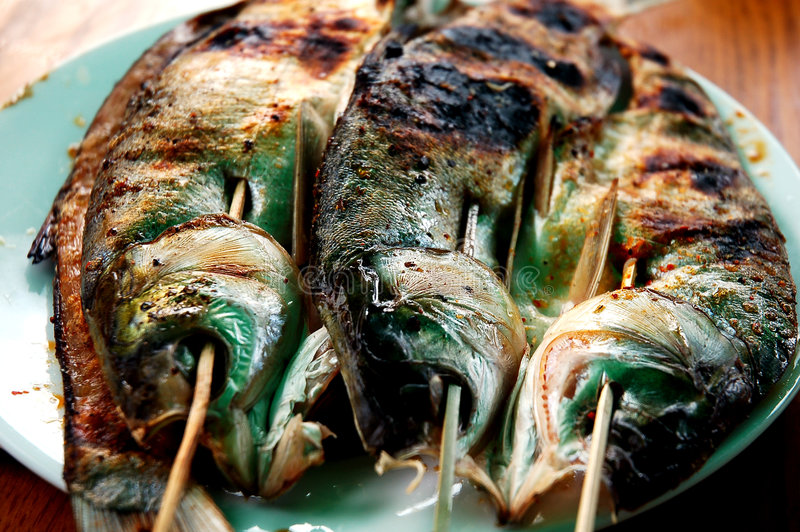 Assado dos peixes foto de stock