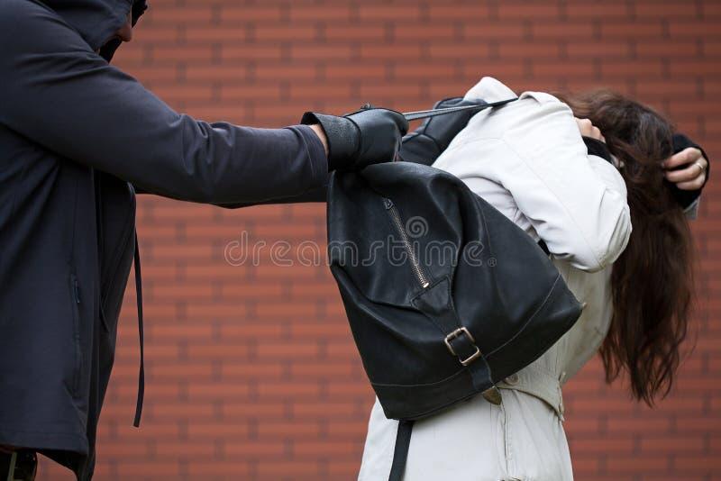 Assaltando um estudante imagens de stock royalty free
