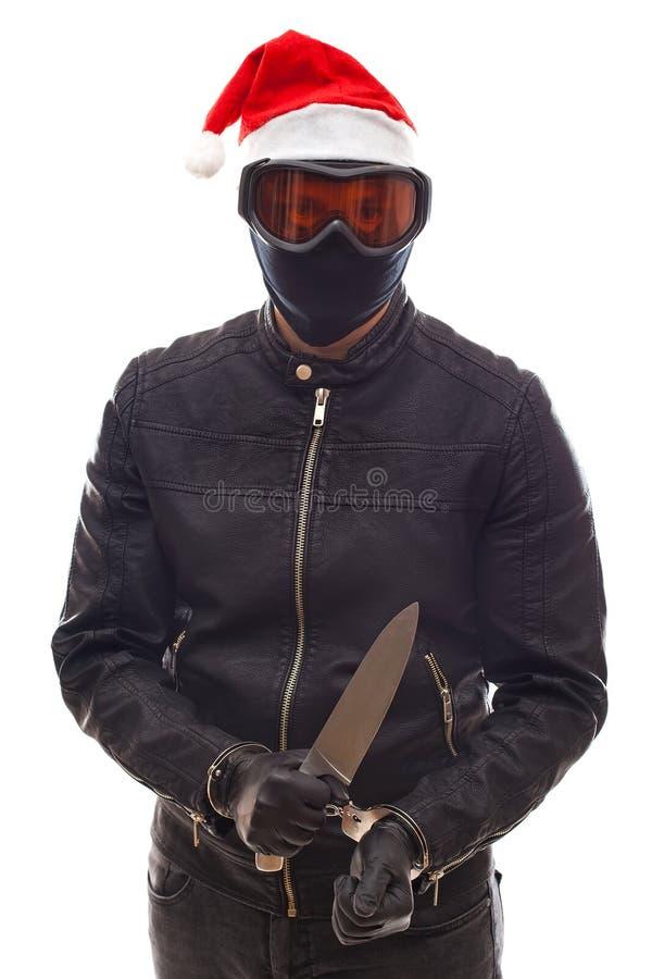 Assaltante perigoso no preto fotografia de stock