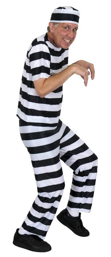 Assaltante Sneaking engraçado do Convict isolado no branco imagem de stock royalty free