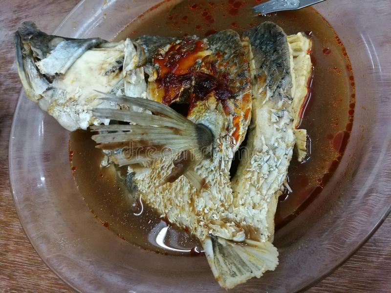 Assam steamed fish head. Malaysia Johor favorite dish, best served with rice royalty free stock images