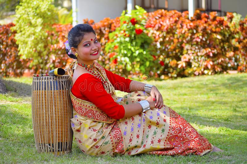 Assamese girl In traditional attire posing with A Dhol, Pune, Maharashtra. Assamese girl In traditional attire posing with A Dhol or Drum, Pune, Maharashtra royalty free stock images