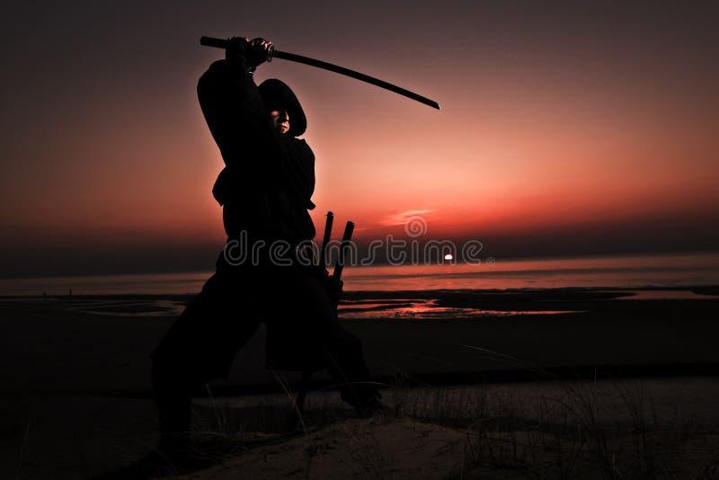 Assassin at the sea stock photo