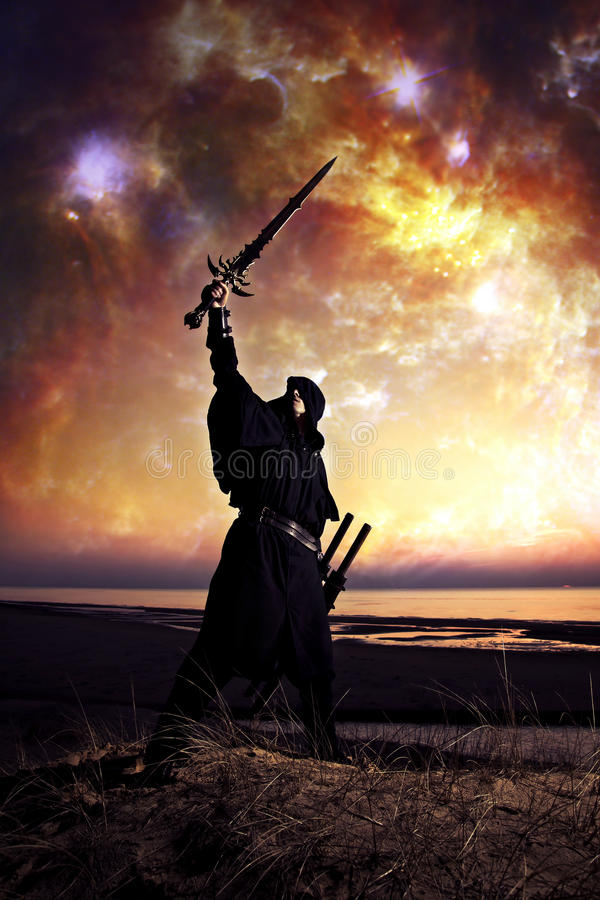 Assassin at starry night. Assassin with sword at the starry night royalty free stock photo