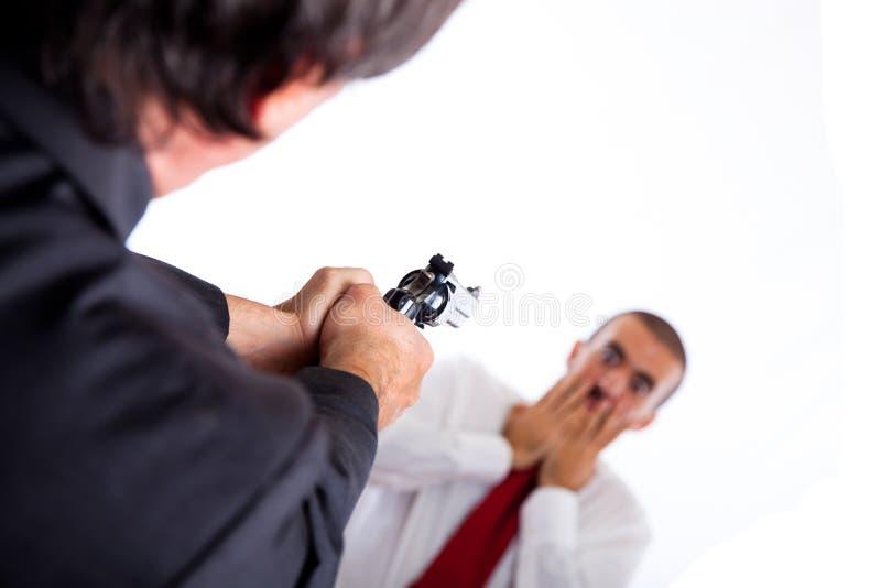 Assassino che mira sull'uomo d'affari fotografia stock