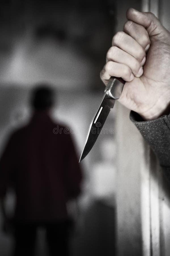 Assassino con il coltello fotografie stock libere da diritti