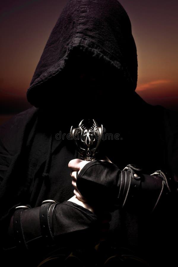 Assassino con la spada fotografia stock libera da diritti