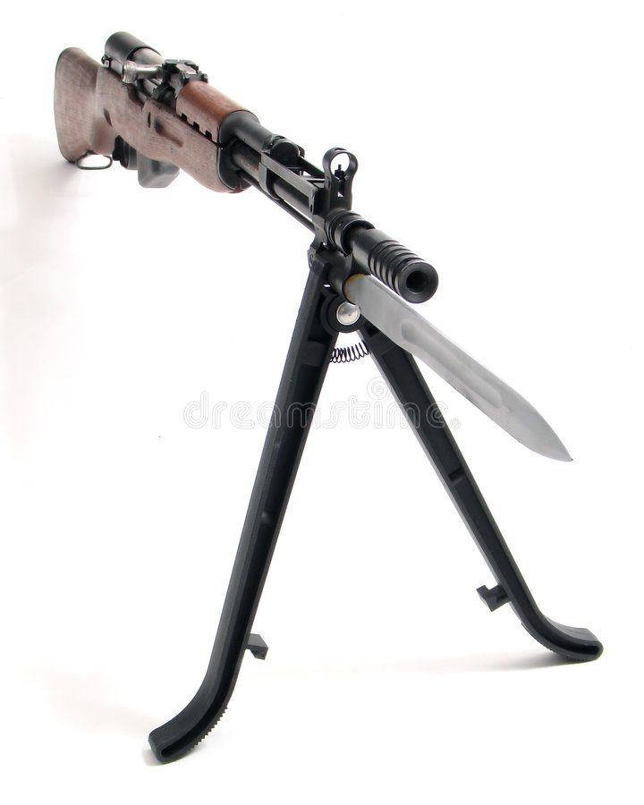 Assault rifle with bayonet. Soviet SKS semi-automatic carbine gun with tripod and bayonet, isolated on white background stock photo