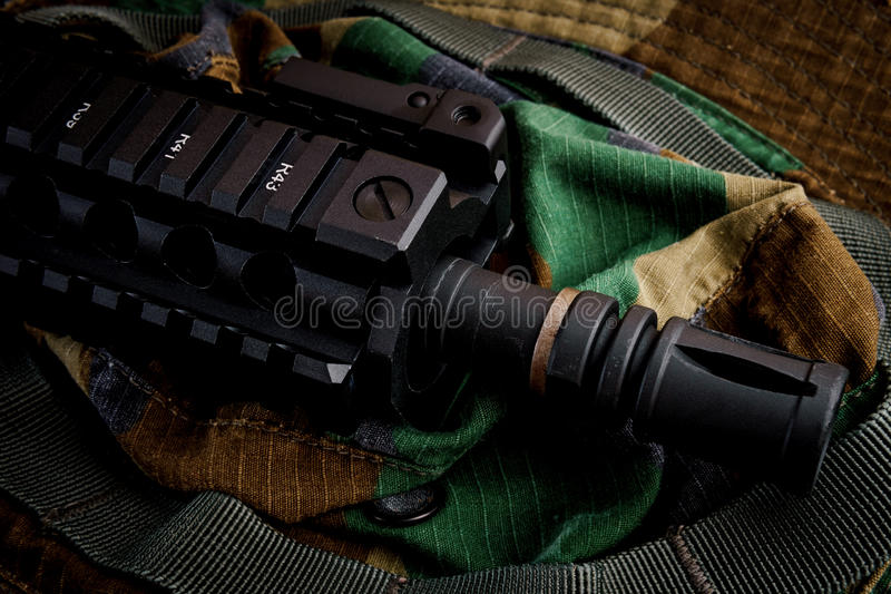 Assault rifle for military background stock images