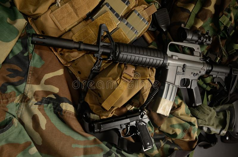 Assault rifle 5.56mm m16 Colt carbine with tactical chest rigs. Military Equipment stock image