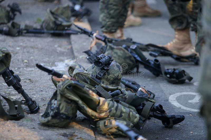 Assault rifles, army helmets with cameras and other army objects stock photo