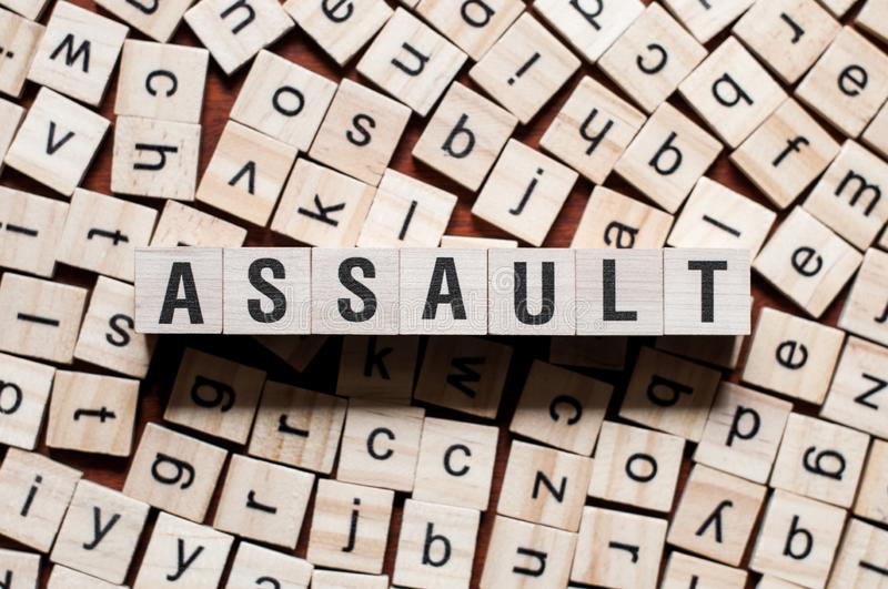 Assault word concept. On cubes royalty free stock photography