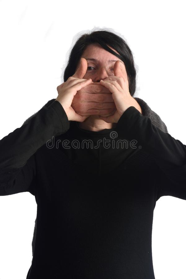 Assaulting and silencing a woman stock image