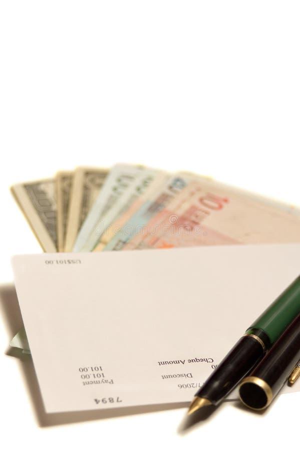 Assegno, soldi, penna fotografia stock