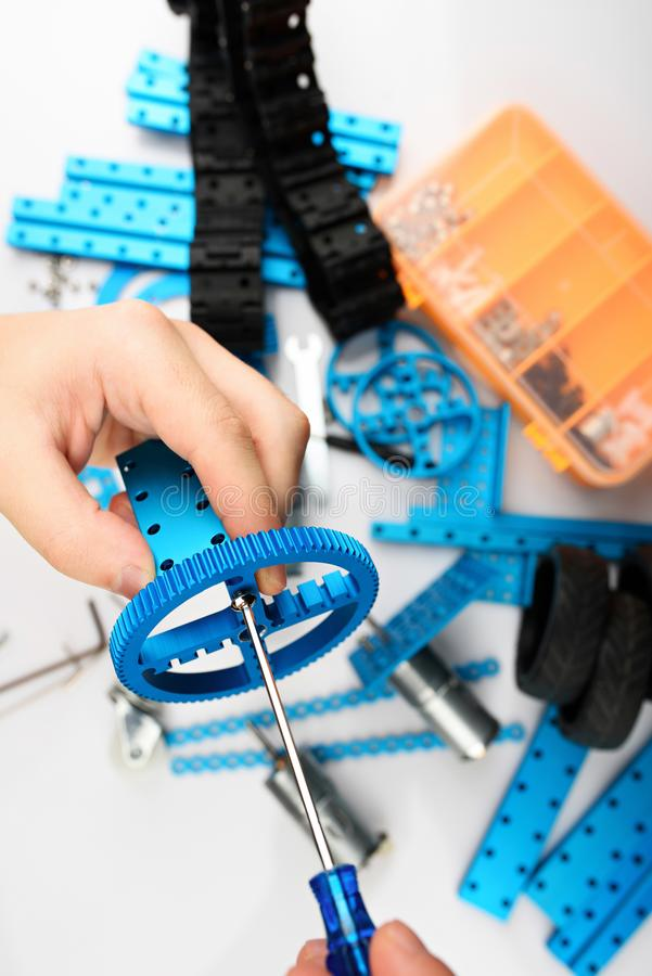 Assemble of DIY kit. Close up view. Hands making RC model royalty free stock images