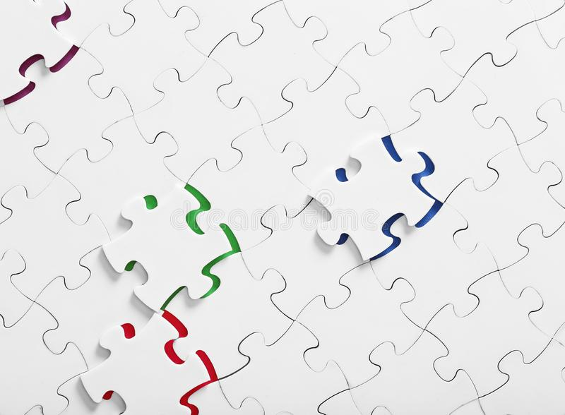 Assembled puzzles with color inserts inside top view vector illustration