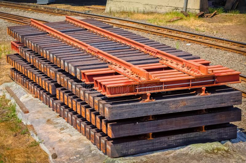 Railroad track sections stacked ready to become part of a railway repair royalty free stock photography