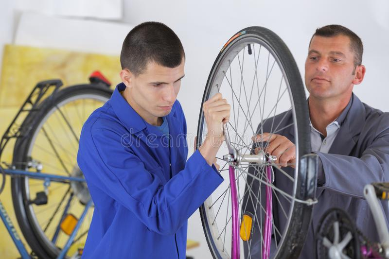 Assembling the bike`s tire. Work stock photo