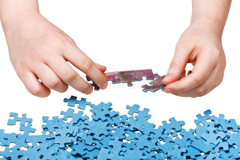 Assembling of jigsaw puzzles isolated. On white background royalty free stock photos