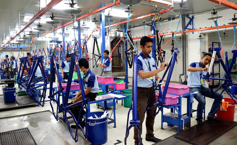 Assembly bicycle bike from Indonesia. SIDOARJO, INDONESIA - APRIL 9, 2015: Workers check on the assembly line at the assembly bicycle bike from Indonesia Polygon royalty free stock images