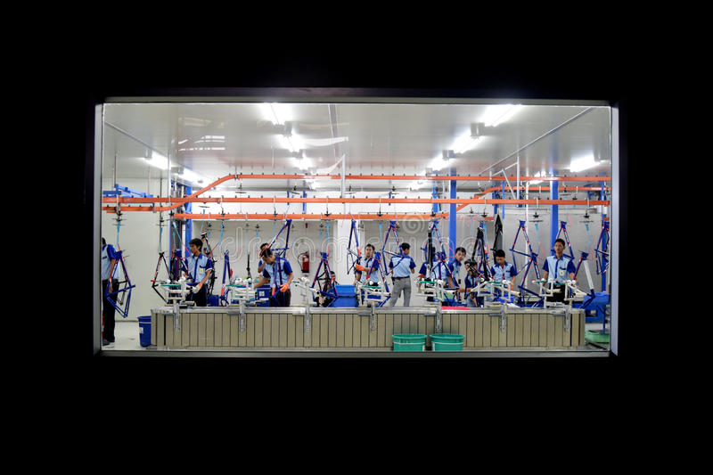 Assembly bicycle from Indonesia. SIDOARJO, INDONESIA - APRIL 9, 2015: Workers check on the assembly line at the assembly bicycle bike from Indonesia Polygon in royalty free stock photography