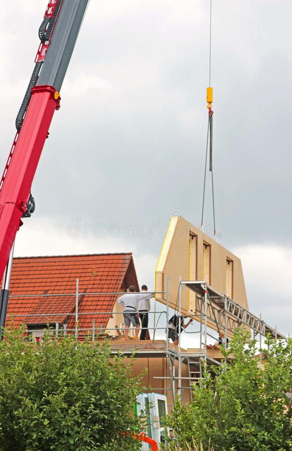 Free Assembly Of A Prefabricated House, Workers Positioning A Gable C Royalty Free Stock Images - 118874509