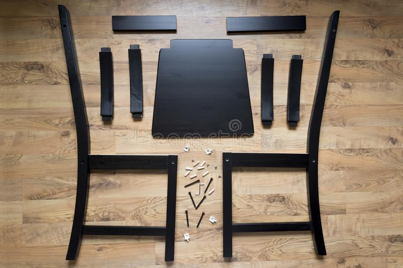 Assembly of wooden furniture, wooden parts of the dining chair stock photography