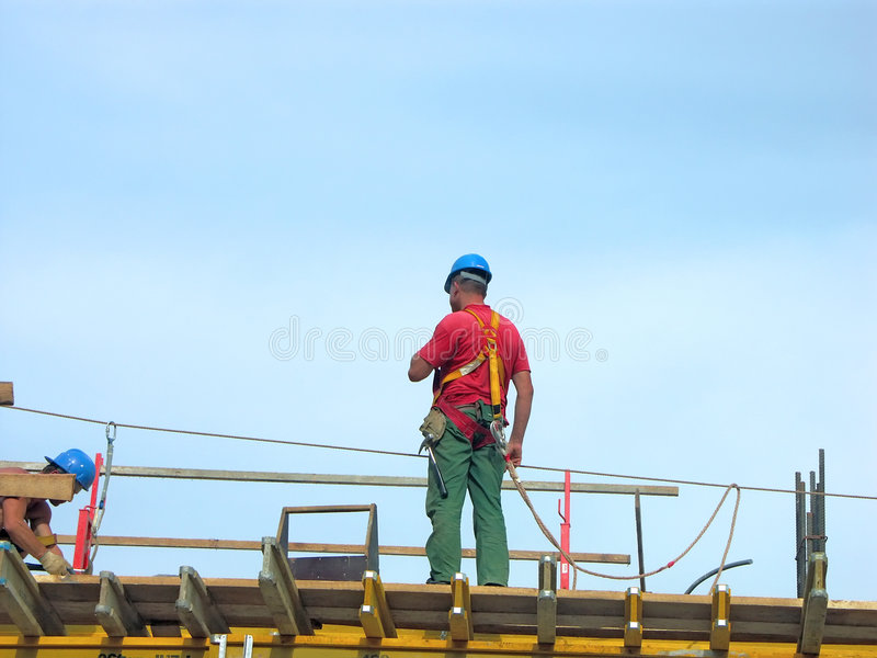 Assembly work. Workers at the construction site stock image