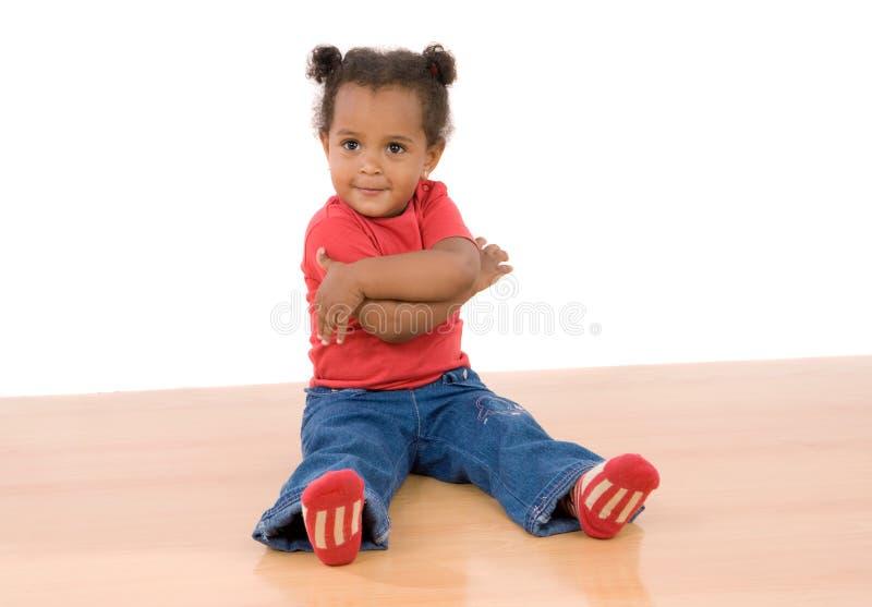 Assento africano adorável do bebê imagens de stock