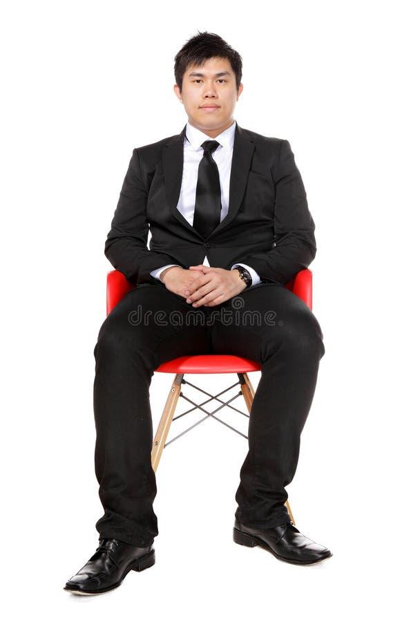 Assento asiático novo do homem de negócio imagem de stock royalty free
