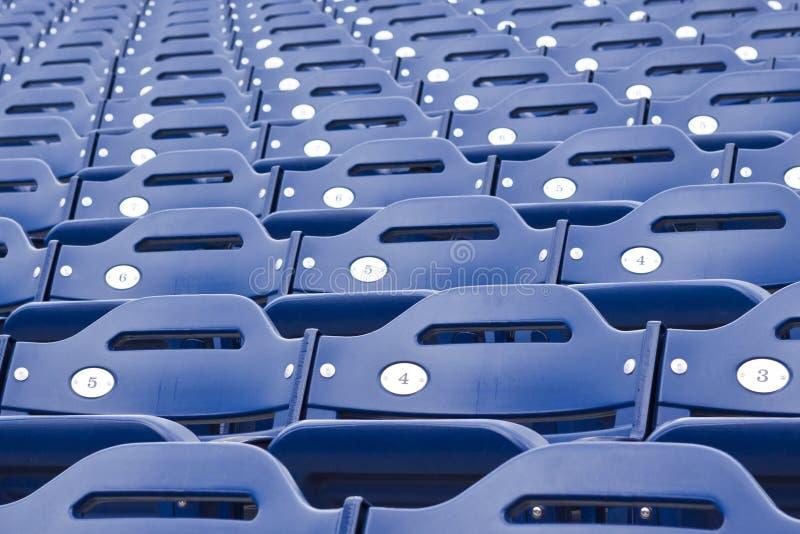 Assento azul do estádio fotografia de stock royalty free