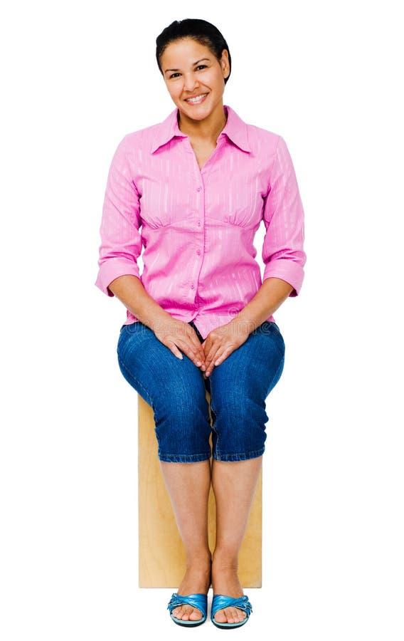 Assento da mulher da raça misturada foto de stock royalty free